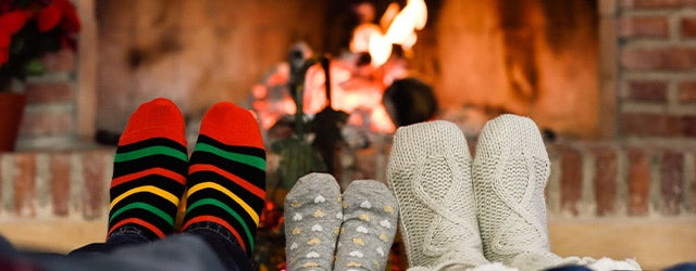 feet with socks on in front of a fire