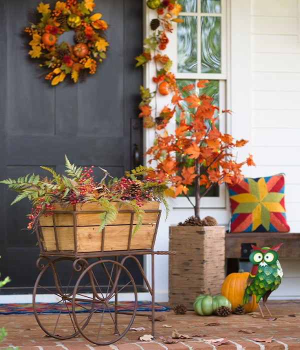 Pumpkins and Pine Cones Fall Garland shown outdoors on front porch