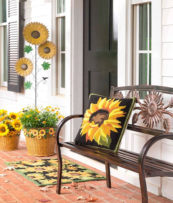 Sunflower Garden Metal Stake and Sunflower Metal Garden Bench and Indoor/Outdoor Sunflower Throw Pillow and Sunflower Indoor/Outdoor Accent Rug shown outdoors on front porch